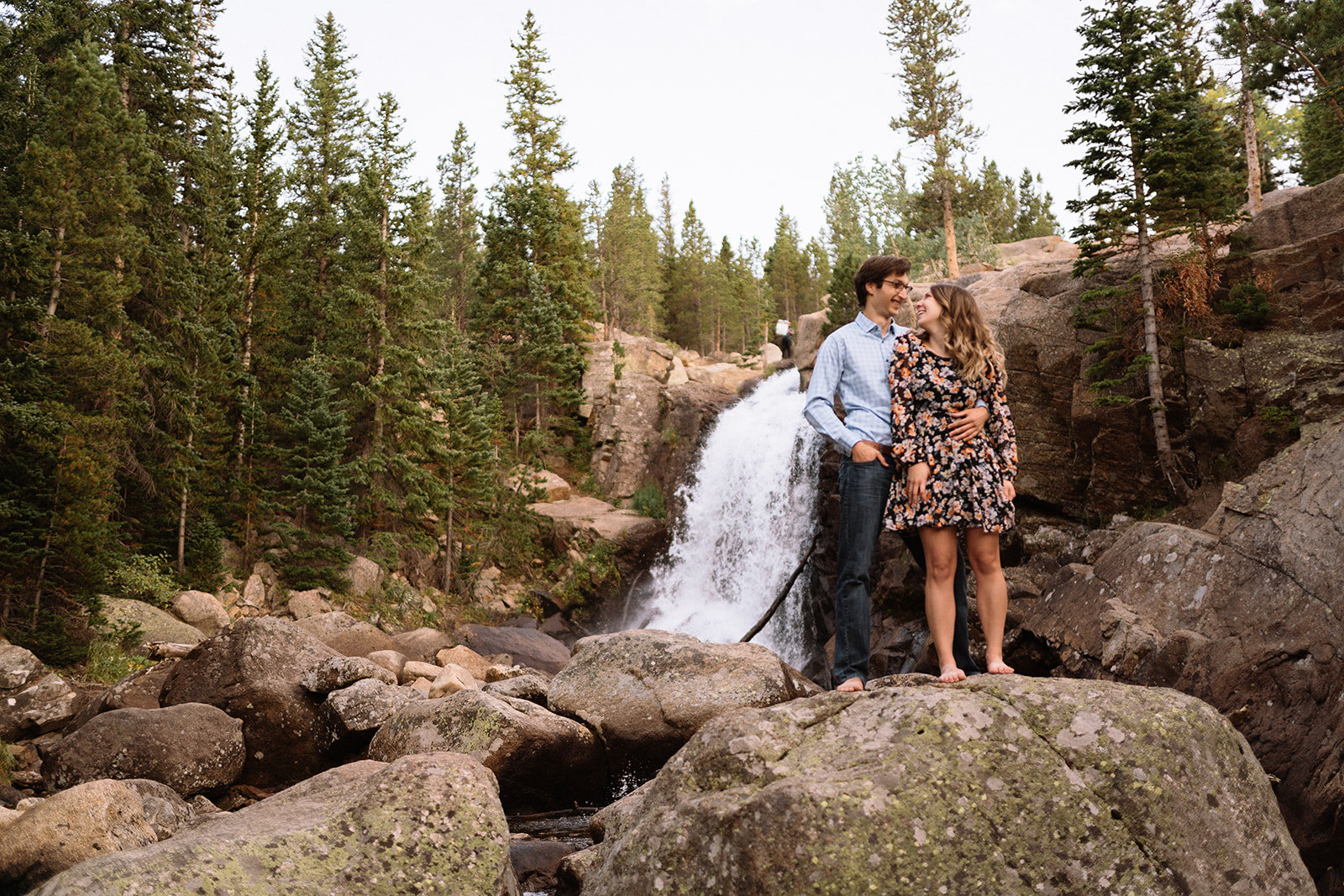 couple engagement outdoors in nature by a water fall